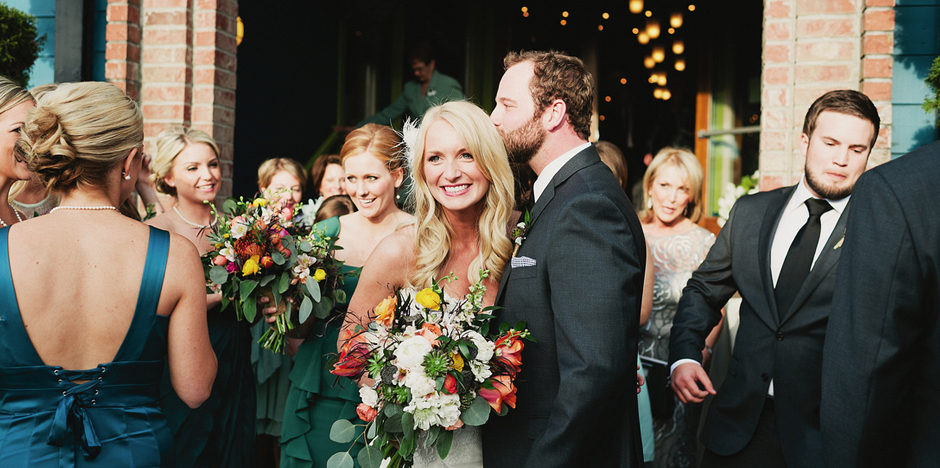 Kristin & Phillip.  Photo by James Moes.  Florals by Paisley Petals