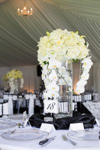 Tall centerpiece, hydrangea, garden roses, lilies, callas, phaelenopsis orchids, white