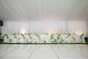 Reception flowers, head table decor, callas, hydrangea, phaelenopsis orchids, rose petals